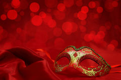 Vintage venetian carnival mask. On red background Royalty Free Stock Photos