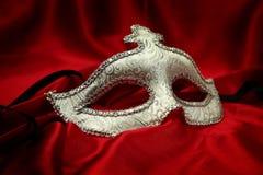 Vintage venetian carnival mask. On velvet background Stock Photo
