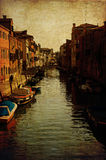 Vintage Venice, view of a canal. Colorful and romantic view of one of the many canali of Venice, on a retro texture with grunge effects stock photos