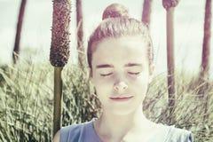 Vintage version of a teenager girl meditates Stock Image