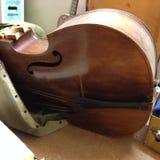 Vintage vertical de 140 años Bass Guitar Imágenes de archivo libres de regalías