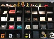 Vintage video game consoles. BANGKOK - DECEMBER 2017: Many vintage video game consoles for sale in Pantip Plaza Stock Photo