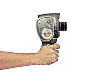 Vintage video shooting. Hand holding retro video camera in vintage style Stock Image