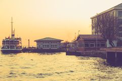Vintage view from Istanbul city with passenger ship, port and seagulls at sunset background. Turkey royalty free stock photography