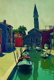 Vintage view of old tower tilted in Burano, Italy Stock Photo