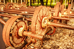 Vintage view of rusty old operational barbells mounted on the stand in public park.  royalty free stock photos