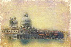Vintage view of Venice, like an old postcard. Colorful and romantic view of the most famous church of Venice, in front of S. Marco, on a retro texture with stock illustration
