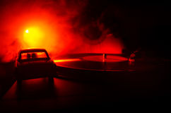 Vintage vinyl record playing on player and acoustic guitar on background with fire orange smoke. Blues concept. Stock Photography