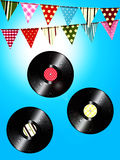 Vintage vinyl records and bunting over sunny sky Royalty Free Stock Photo