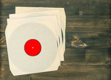 Vintage vinyl records on rustic wooden background Royalty Free Stock Image