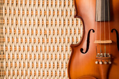 Vintage violin on bamboo weave background. With copy space Stock Images