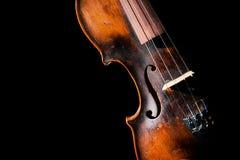 Vintage violin on black background Stock Images
