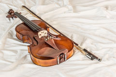 Vintage violin on cloth Stock Photos