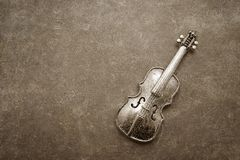 Vintage violin decoration. Over scratched background stock photos