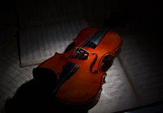 Vintage violin on the sheet music. Royalty Free Stock Photos