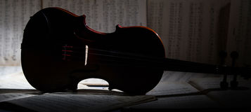 Vintage violin on the sheet music. Royalty Free Stock Images