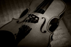Vintage violin on the sheet music. Stock Photos