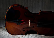 Vintage violin on the sheet music. Stock Photo