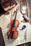 Vintage violin and sheets Stock Photos