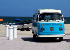 Vintage Volkswagen on the beach. A light blue and white coloured vintage Volkswagen parked by the beach royalty free stock photography
