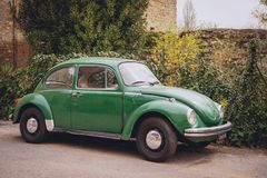 Vintage Volkswagen Beetle. Italy, 2017. A vintage Volkswagen Beetle parked on the street of a town in Italy. Landscape format stock photo