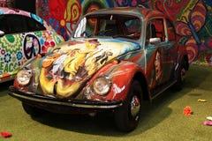 Sixties volkswagen beetle. Vintage Volkswagen beetles with psychedelic hippie design as seen in Autoworld museum in Brussels, Belgium Stock Photo