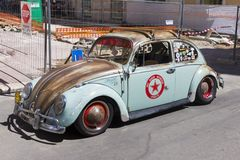 Vintage Volkswagen car in a parking line. Vintage Volkswagen car that is still in use parked in a parking line in Bari city in Italy stock photo