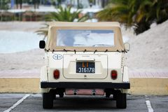 Vintage Volkswagen Thing Car. Menton, France - December 7, 2018: Beautiful Vintage Volkswagen Thing 1973 Rear View Car On The Beach, Mediterranean Sea, French royalty free stock photo