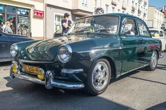 Vintage Volkswagen on a veteran cars meeting. Right side and front view of vintage classic dark green German Volkswagen with ait cooled engine on parade on a royalty free stock image
