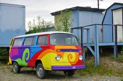 A vintage  Volkswagen (VW) camper van painted with psychedelic hippy colors Royalty Free Stock Images