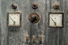 Vintage Volt and Ampere Meter with lights and switches in rusty cabinet royalty free stock photo
