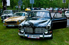 Vintage Volvo Amazon and other classic cars. Show of an vintage beautiful Swedish Volvo Amazon during old cars race in Northern Poland. Volvo P1800 and Saab 95 Royalty Free Stock Photos