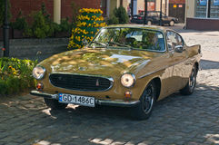 Vintage Volvo P1800 E. Classic retro car Volvo P1800 in yellow during old cars race in Wejherowo, Poland Royalty Free Stock Photo