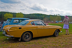 Vintage Volvo P1800 and its lady. Retro yellow Volvo P1800 and his driver during old cars race in Northern Poland stock photos