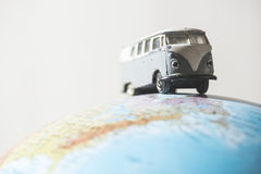 Vintage VW bus on globe Royalty Free Stock Photo