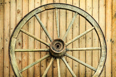 Vintage wagon wheel in front of a barn Stock Photo