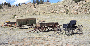 Vintage wagons. Collection of vintage wild west four-wheeled wagons in Colorado, America with copyspace Stock Photography