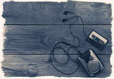 Vintage walkman cassette player with earbuds and tape cassette. Retro style toned image. Selective focus Royalty Free Stock Image