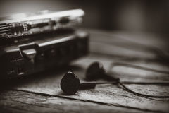 Vintage walkman cassette player with earbuds and tape cassette Royalty Free Stock Photos