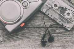 Vintage walkman cassette player with earbuds and tape cassette Stock Photos