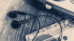 Vintage walkman cassette player with earbuds and tape cassette. Retro style toned image. Selective focus Stock Image