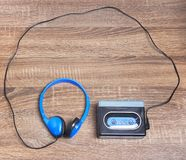 Vintage walkman and headphones. On the wooden background Stock Image