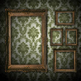 Vintage wall background with empty gold frame Stock Photography