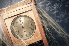 Vintage wall clock full of cobwebs Stock Photo