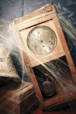 Vintage wall clock full of cobwebs Stock Images