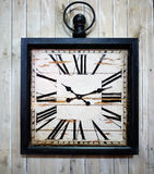 Vintage wall clock. Old vintage clock on a wooden wall. Closeup Stock Photo
