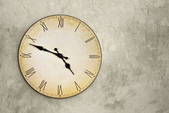 Vintage wall clock over grey grunge background Stock Images