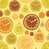 Vintage wall clocks and alarm clocks, seamless gold background Royalty Free Stock Images