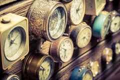 Vintage wall with clocks. Closeup of vintage wall with clocks royalty free stock photography