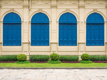 Vintage wall and four blue windows Royalty Free Stock Photography